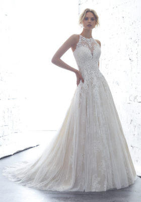 Mori Lee 1702.  Guipure Lace Appliqus Accent the High Halter Bodice on This Soft English Net Over Chantilly Lace Ballgown. A Sheer Racer Back Trimmed in Covered Buttons Completes the Look. Colors Available: White, Ivory, Ivory/Crme.