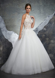 Mori Lee 5608.  Crystal Beaded Alenon Lace Appliqus Adorn the Gorgeous Sheer Bodice on This Tulle Bridal Ball Gown. A Beautiful Racer Back Trimmed in Covered Buttons Completes the Look. Matching Satin Bodice Lining Included. Colors Available: White, Ivory, Ivory/Nude.