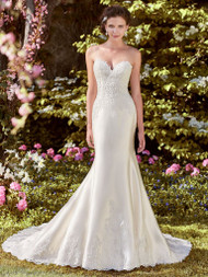 Rebecca Ingram Laynie.  Embroidered lace motifs accent the bodice and hemline of this Elodie Mikado fit-and-flare wedding dress, completing the strapless sweetheart neckline. Lined with Viva Jersey for a luxe fit. Finished with covered buttons over zipper and inner elastic closure. Illusion cap-sleeves accented in lace motifs sold separately. Available in: All Ivory, Ivory over Light Champagne, shown.