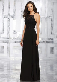 Mori Lee 21542.  A Delicately Beaded Lace Bodice and Chiffon A-Line Skirt Create The Perfect Bridesmaids Look. Criss Cross Back Straps Complete the Look. View Lace Swatch Card for Color Options. Shown in Black.