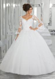 Mori Lee 60015.  Feminine Bell Sleeves and Lace Details Create the Perfect Princess Look. Delicate Beading Accent the Bodice and Tulle Skirt. Colors Available: Blush, Bahama Blue, White.