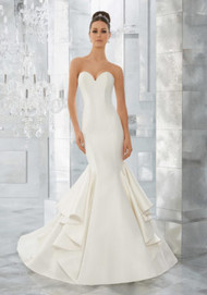 Mori Lee 5563. Simple and Chic, This Marcella Satin Sculptured Mermaid Features a Romantic Sweetheart Neckline and Covered Button Detail Along the Back. Shown with Pearl and Diamant Beaded Alenon Lace Jacket (not inlcuded), Sold Separately as Style #11275. Colors Available: White and Ivory.