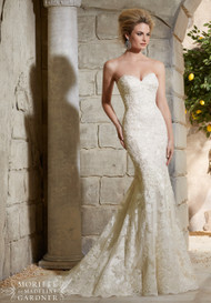 """Mori Lee 2782.  Fit and flare with alencon lace over soft satin with a touch of crystal beadwork.  Available in white, ivory, and light gold.  Available in three length, 55"""", 58"""", and 61""""."""