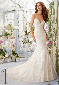 "Mori Lee 5415.  Scalloped alencon lace edging contours the net gown with appliques and crystal beading.  Available in three lengths:  55"", 58"", and 61"".  Available in White, Ivory, Ivory/Light Gold, and Ivory/Blush."