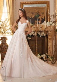 Mori Lee 5468.  Soft tulle a-line accented with lace appliques.  Available in White, Ivory, and Ivory/Blush.