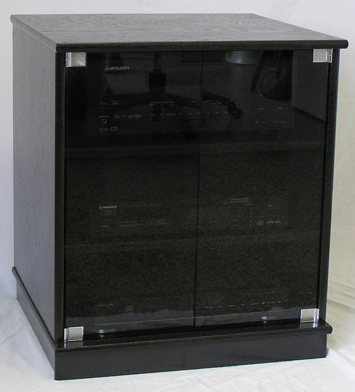of small black oak TV stand with gray tint glass doors ...