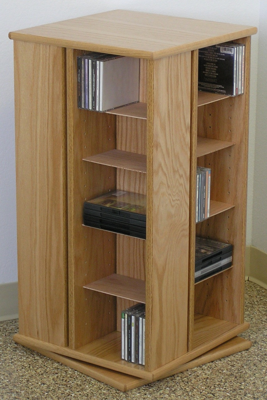 Awesome Swivel DVD Storage Cabinet 30 Inches High Shown In Natural Oak Finish.
