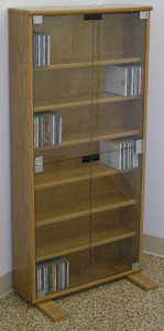 "DVD storage cabinet 48""H shown in Light Brown Oak with clear glass doors. decibeldesigns.com 888.850.5589"