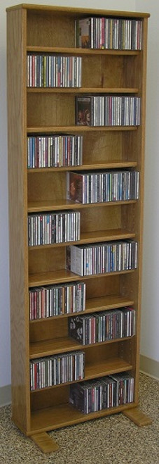 DVD rack 72 inches high shown in light brown oak finish. Comes with 10 adjustable shelves. All cabinet grade plywood construction. Beautiful satin finish.tel 888.850.5589 decibeldesigns.com