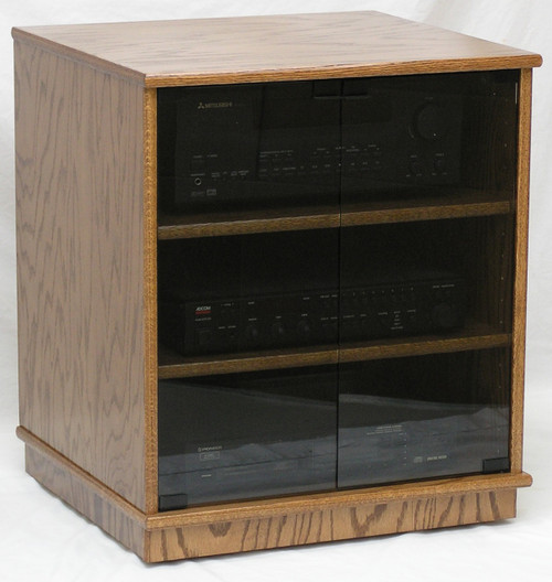"Stereo rack 27"" high with glass doors. Shown in Minwax Special Walnut stain color and gray tint tempered glass doors.  2 adjustable shelves standard.  http://www.decibeldesigns.com 888.850.5589"