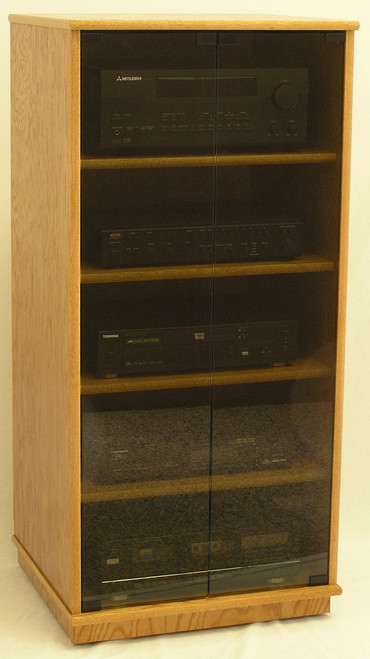Stereo cabinet 50 inches high with gray tint glass doors. 1 pair full length tempered glass doors. 4 adjustable shelves.  Shown in light brown oak with satin sheen top coat. http://www.decibeldesigns.com 888.850.5589