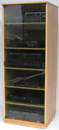 Audio rack with glass doors. Shown in light brown oak finish with gray tint tempered glass doors. decibeldesigns.com  888.850.5589