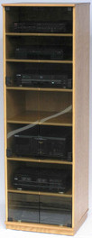 Audio cabinet with glass doors 73 inches high. Shown in light brown oak finish with gray tint tempered glass doors. 6 dual wheel casters hidden behind trim. decibeldesigns.com 888.850.5589