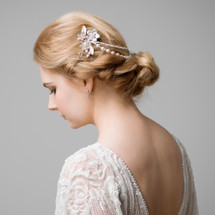 Beautiful handmade hair chain in pearl & crystal with combs embellished with vintage style flowers & enamel sprayed metal leaves. Great for adding some gold tomes to your bridal accessories. Wear draped around a bun or a low updo for a soft vintage look.