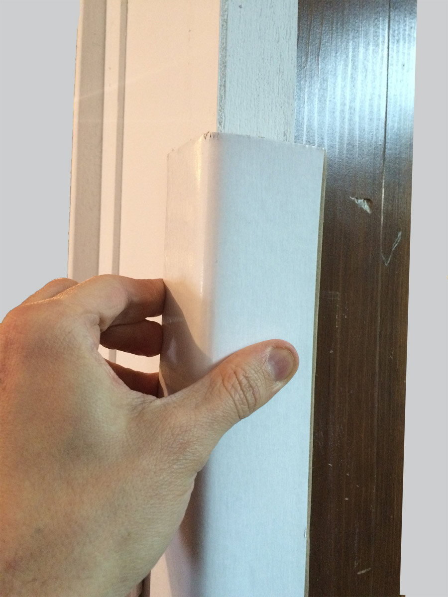 Easily apply Corner Barrier™ to door jamb edge, affix with painter's tape. Easily apply Corner Barrier™ to door jamb edge, affix with painter's tape in less than a minute.