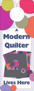 FQG312 Knobie Talk Door Hanger-A Modern Quilter Lives Here