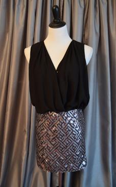 Black Sleeveless Dress With Sequin Skirt