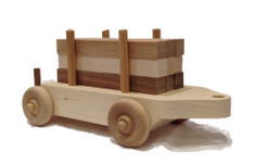 "The log car comes loaded with nine six-inch logs of maple, walnut and cherry that children like to load and unload. When combined with the tender's blocks and a little imagination, the building can go on for hours. The log car is 12"" long x 4"" wide."