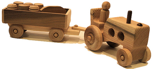 "This farm tractor is just like the one grandpa and grandma drove down on the farm. It includes a driver and six little pickle barrels and milk jugs in a detachable trailer. All you need is junior to push it along the floor. The tractor and trailer are crafted of oak or walnut and maple. They are 15"" long x 4"" high x 3"" wide."