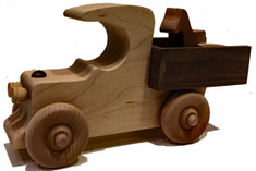 "Our classic vehicle is ideal for pushing, loading and unloading. The pickup truck includes a small wooden horse and a feed bucket, but you can deliver it filled with candy or a special treat to a child. It is hand crafted of maple and walnut and has a walnut stripe down the middle and is 8"" long x 4"" high x 2"" wide."