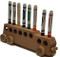 """Our school bus cleverly holds eight markers upside down, so they won't dry out or be misplaced. The bus is 11"""" long x 3"""" high x 2"""" wide and sits nicely on a desk. We craft it in maple or oak and give you the markers, too. The school bus is a popular gift for bus drivers, teachers, and college students, as well as the younger set."""
