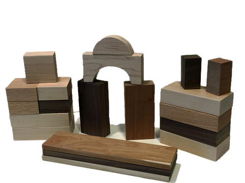 """A crafted a set of twenty two blocks from cherry, walnut, maple and oak. The set includes six large rectangles, five squares, one arch, one half circle, four pillars, two half pillars and three planks. Finished with fine sanding. Why? So there are no paint chips or stains that might end up in a child's mouth. And because finely sanded hardwood is beautiful and smooth as glass."""""""