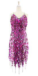 Short handmade sequin dress, in metallic fuchsia paillette sequins with silver faceted beads, a luxe grey fabric background and a jagged beaded hemline front view