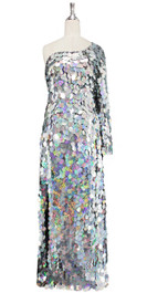 Long handmade sequin dress in hologram silver paillette sequins with silver faceted beads and a luxe grey fabric background in a one sleeve cut front view