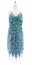 Short handmade sequin dress, in pearl iridescent blue paillette sequins with silver faceted beads, a luxe grey fabric background and jagged, beaded hemline front view