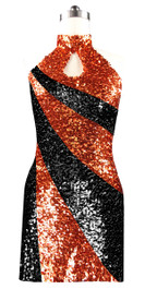 Short patterned dress in metallic black and copper sequin spangles fabric with a keyhole Chinese collar front view
