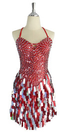 A short handmade sequin dress, with 10mm hologram red fishscale sequins overlaid with silver faceted beads on the bodice and with rectangular hologram red and silver mixed paillette sequins on the skirt area front view.   This gorgeous dress is in-stock and ready to ship. (You may order this dress in your own size with a making time of around 4 to 5 weeks, plus shipping time. Please contact us for more details of how to order in your own size.)  (MEASUREMENTS are shown as inches / cm) are:  SIZE: : US 6 / UK 8 / EUR 38    BUST: 36 / 92  WAIST: 28 / 72  HIPS: 38 / 97  G: (min top of shoulder to waist): 16 / 41     SKIRT LENGTH: 15 to 18 / 39   (from waist down)  Order slightly larger if unsure as you can adjust down in sizing with a seamstress local to you once your item arrives. (Normally we leave about 1 inch of fabric on inside seams to allow you to let an item out slightly.)   Lining: yes   Stretch: yes (1 to 2 inches across body)    Composition: P.E.T. sequins on 95% polyester 5% spandex base    Care: Cold water delicates or hand wash: test first. Dry flat. Do not iron.
