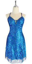A short handmade sequin dress, in 8mm cupped hologram blue sequins with a straight, beaded hemline front view.   This gorgeous dress is in-stock and ready to ship. (You may order this dress in your own size with a making time of around 4 to 5 weeks, plus shipping time. Please contact us for more details of how to order in your own size.)  (MEASUREMENTS are shown as inches / cm) are:  SIZE: : US 6 / UK 8 / EUR 38    BUST: 36 / 92  WAIST: 28 / 72  HIPS: 38 / 97  G: (min top of shoulder to waist): 17 / 44     SKIRT LENGTH: 17 / 44  (from waist down)  Order slightly larger if unsure as you can adjust down in sizing with a seamstress local to you once your item arrives. (Normally we leave about 1 inch of fabric on inside seams to allow you to let an item out slightly.)   Lining: yes   Stretch: yes (1 to 2 inches across body)    Composition: P.E.T. sequins on 95% polyester 5% spandex base    Care: Cold water delicates or hand wash: test first. Dry flat. Do not iron.