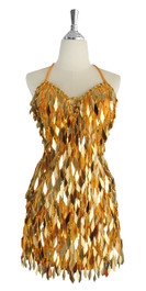 A short handmade sequin dress, in diamond-shaped metallic gold sequins front view