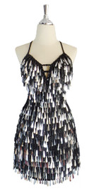 A short handmade sequin dress, with tear-drop shaped metallic silver paillette sequins, black faceted beads front view