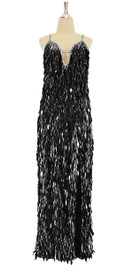 A long handmade sequin dress, in black diamond-shaped paillette hanging sequins and silver beads with plunge neckline front view