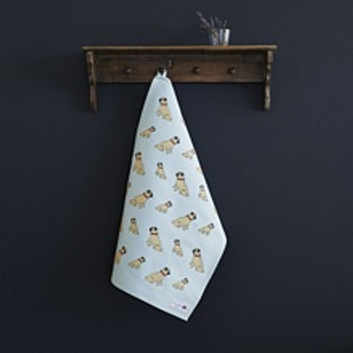 Organic cotton tea towel covered in pugs form Sweet William Designs.