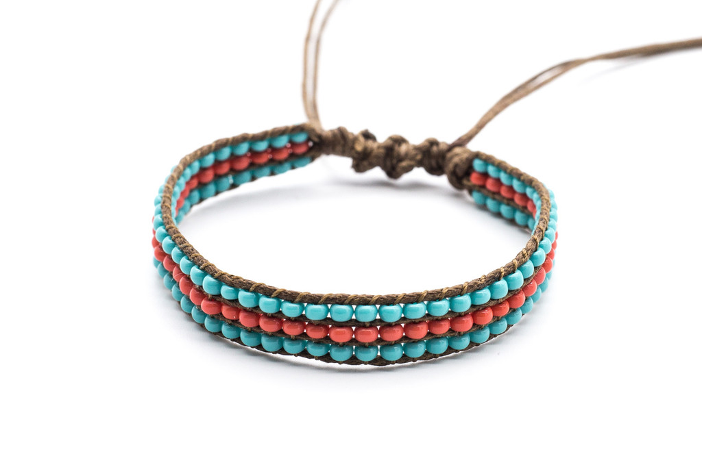 Beautifully handwoven bohemain chic braided natural brown silk thread bracelet with round tantalizing turquoise and harmoinous pink coral fire polished beads. One size, adjustable cord.