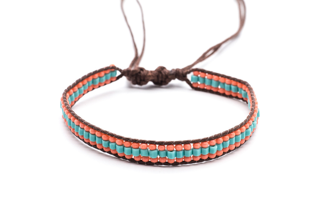 Beautifully handwoven bohemain chic braided dark brown silk thread bracelet with round harmonious pink coral and  tantalizing turquoise bugle fire polished beads. One size, adjustable cord.