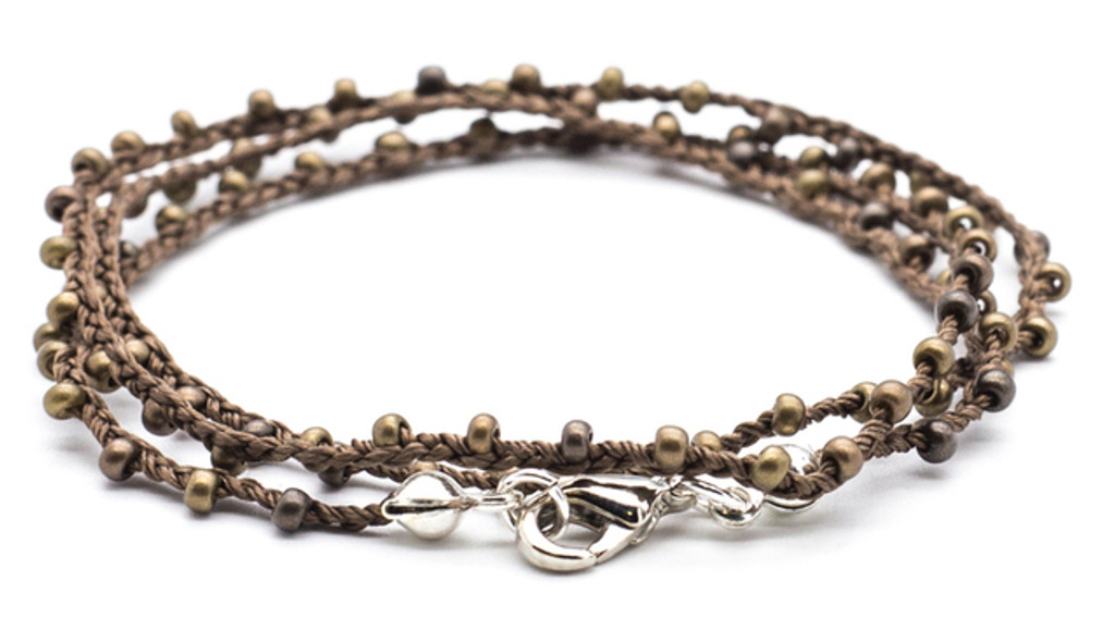 """16"""" braided brown silk thread necklace with bronze dorada seed beads and silver plated clasp."""