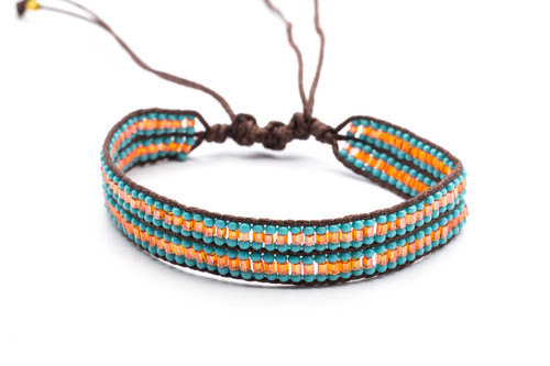 Beautifully handwoven bohemain chic braided brown silk thread bracelet with round tantalizing turquoise and fire opal bugle fire polished beads. One size, adjustable cord.
