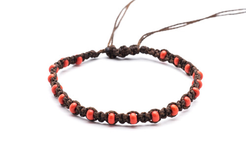Beautifully handwoven bohemian chic braided dark brown silk thread bracelet with round seductive red coral fire polished beads. One size, adjustable cord.