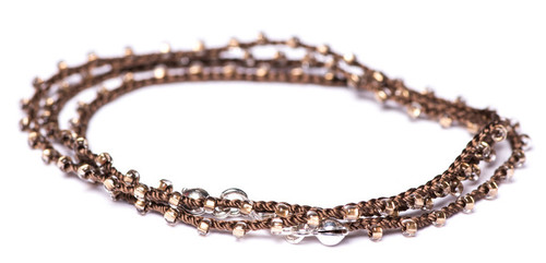 "18"" braided brown silk thread necklace with irresistible crystal clear seed beads and silver plated clasp."