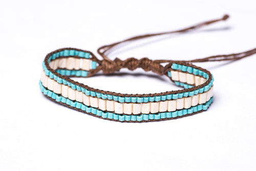 Beautifully handwoven bohemain chic braided brown silk thread bracelet with angelic ivory and alluring turquoise bugle beads. One size, adjustable cord.