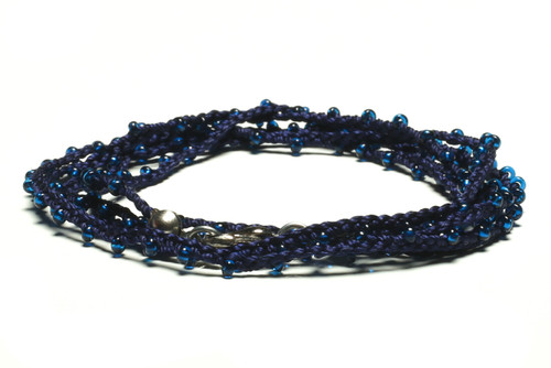 "32"" braided black silk thread necklace with transluscent cobalt blue seed beads and silver plated clasp"