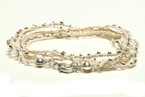 "32"" braided white silk thread necklace with white seed beads and silver plated clasp"