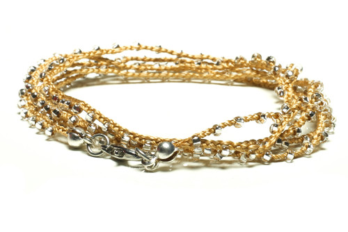 "32"" braided gold silk thread necklace with clear seed beads and silver plated clasp"