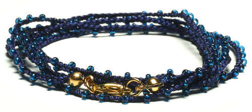 "32"" braided navy blue silk thread necklace with transparent navy blue seed beads and gold plated clasp"