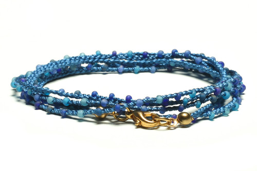 "32"" braided blue silk thread necklace with matte blue seed beads and gold plated clasp"