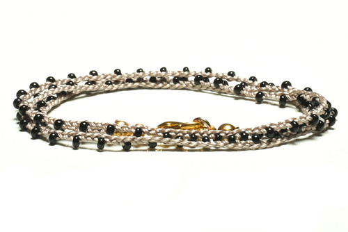 "16"" braided steel grey silk thread necklace with black seed beads and gold plated clasp"