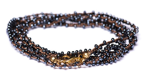 "Timeless 32"" braided brown silk thread necklace with tantalizing double beaded gunmetal seed beads and gold plated clasp."